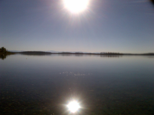 sun reflecting on a lake